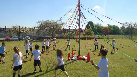 Children Reception classes at Angel Road Infant School have been Maypole dancing as part of this ter