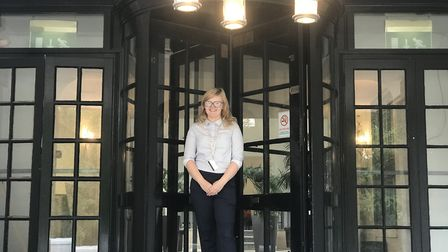 Courtney Cook, Guest and Services supervisor, outside the entrance of the newly refurbished The Boud