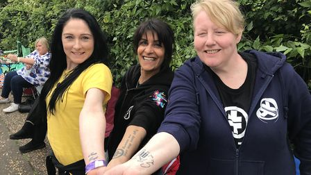Allegiance in ink, Take That fans outside Carrow Road show off their tattoo's of the boys. Picture: