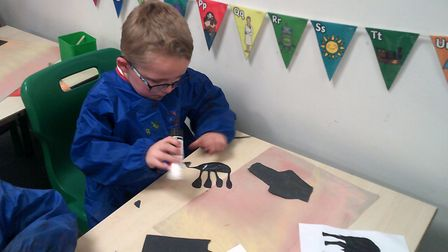 Year 1 at Northfield St Nicholas Primary Academy created African Silhouettes. They blended chalk to