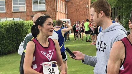 Juliette Watkinson speaks to Mark Armstrong after winning the Holt 10K. Picture: Supplied