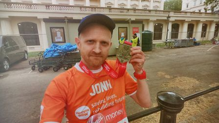 John Fensom with his London Marathon medal that completed his 12 in 12 challenge. Picture: John Fens
