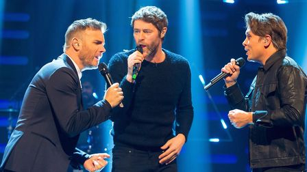 Take That (left to right) Gary Barlow, Howard Donald and Mark Owen during filming of the Graham Nort