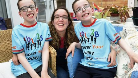 Nine-year-old twins Thomas, left, and Daniel Bristow, who have started walking despite being told th