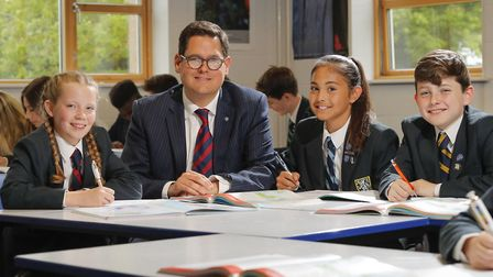Students at Wymondham College with headteacher Dan Browning. The college's boarding provision has re