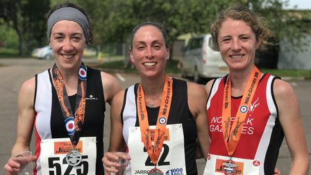 The first three ladies finished at teh MIke Grove 10K. From left to right: Jess Behan (2nd), Amy Bec