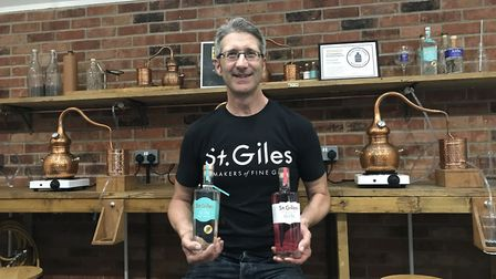 St Giles head distiller, Pete Margree, with two of their award winning gins. Picture: Ella Wilkinson