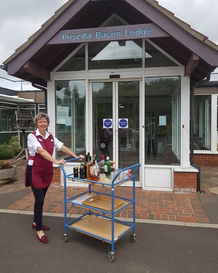 Carolyn Hamerton, a volunteer at Priscilla Bacon Lodge, with her drinks trolley sponsored by the PBL