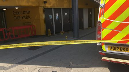 Police have cordoned off an area near to the Rose Lane car park after the murder of a man. PIC: Pete