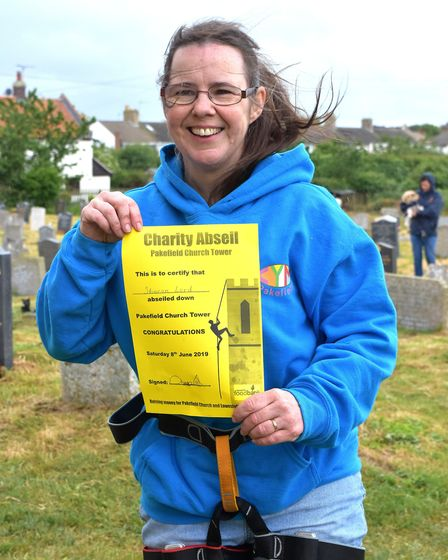 The Rev Sharon Lord after completing the descent. Picture: Mick Howes