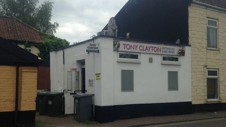 Two masked men violently beaten a man before stealing a large quantity of cash from Tony Clayton bet