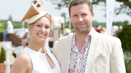A couple on Fakenham Racecourse's Ladies Day, with an ice-cream-styled hat. PICTURE: Keiron Tovell