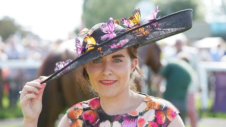 A lady sporting a butterfly-themed hat and dress at Fakenham Racecourse Ladies Day 2018 PICTURE: Kei