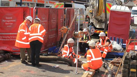Workers inspecting the sinkhole in High Street, Sheringham.Photo: KAREN BETHELL
