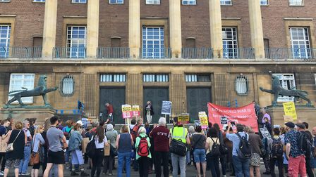 Lesley Grahame, Green Party Norwich city councillor, speaks to a rally outside City Hall protesting