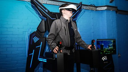 Callum Fey, 12, tries his hand on a simulator Picture: Chris Bishop
