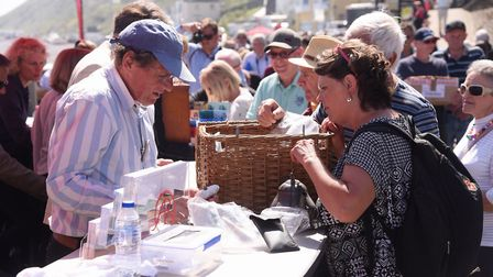 Experts assessing items the public brought along to the filming of the Antiques Roadshow at Cromer.