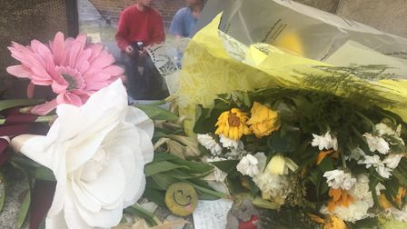 Flowers left at the scene of Rose Lane murder. PIC: Peter Walsh.