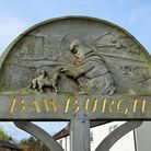 The village sign at Bawburgh depictung St Walstan. Picture: Dr Andrew Tullett