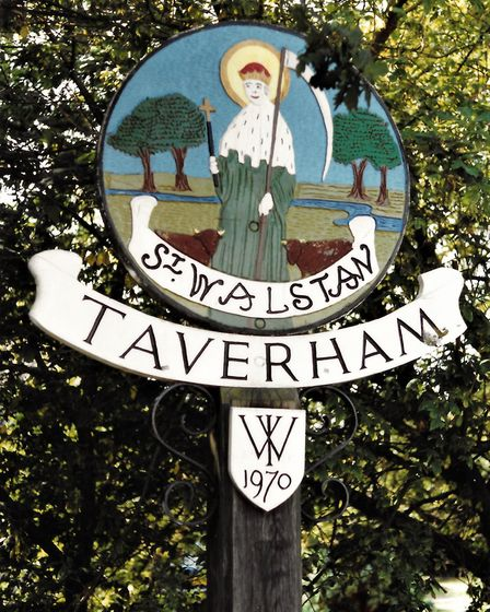 The earlier Taverham village sign, which also showed St Walstan, who forsook all riches in pursuit o
