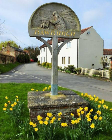 The Bawburgh village sign, which depicts St Walstan attending to two lambs. Picture: Dr Andrew Tulle