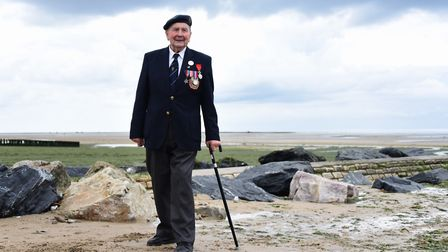 D-Day veteran David Woodrow, proudly stands at Gold Beach 75 years after landing there. Picture: DEN