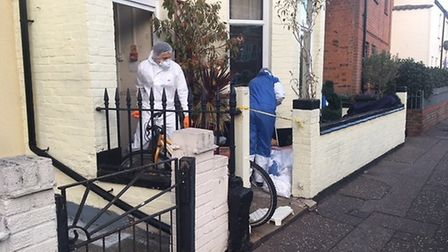 Forensics comb the scene in South Market Road where a man was fatally stabbed. Picture: Liz Coates