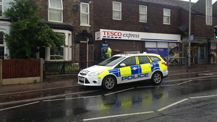 Police outside the Tesco Express in Magdalen Road, near to where the second carjacking took place in