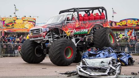 The Red Dragon monster truck in action.