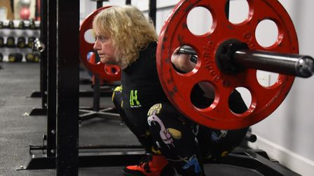 Powerlift record holder, Mandy Bush, 51, in training in Norwich doing the squat lift. Picture: DENIS