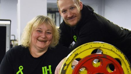 Powerlift record holder, Mandy Bush, 51, with her trainer Dom Hills. Picture: DENISE BRADLEY