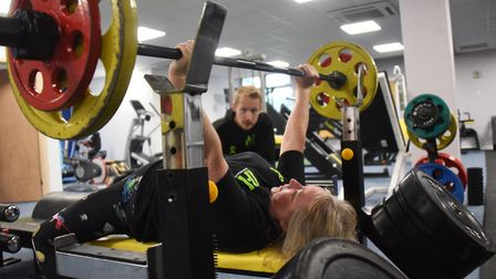 Powerlift record holder, Mandy Bush, 51, in training in Norwich doing the bench lift, with her train