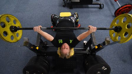 Powerlift record holder, Mandy Bush, 51, in training in Norwich doing the bench lift. Picture: DENIS