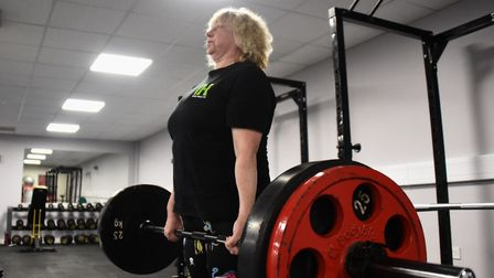 Powerlift record holder, Mandy Bush, 51, in training in Norwich doing the dead lift. Picture: DENISE