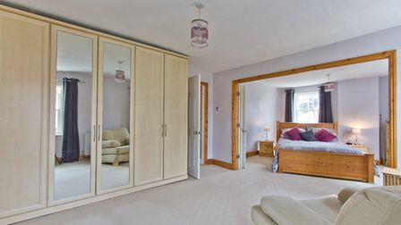 Bi-folding doors separate the two main bedrooms, allowing you to create one impressive master suite.