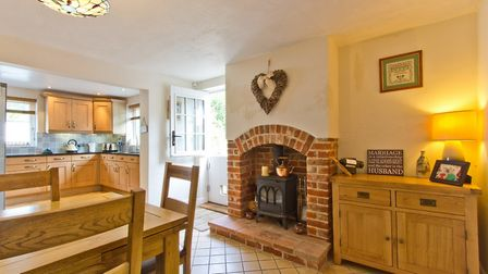 The property boasts a cosy, country-style kitchen, equipped with a number of integrated appliances a