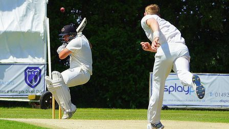 Peter Trewick sends down a bouncer during Great Witchingham's emphatic win over Vauxhall Mallards at