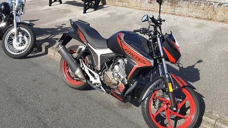 The motorbike (right) which was stolen from Potters Resort car park in Hopton and set on fire at St