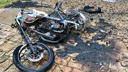A motorbike was set on fire underneath the church building. Picture: Ian Wall