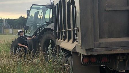 A tractor whcih was stopped by Norfolk Police after the driver was witness using a mobile phone behi