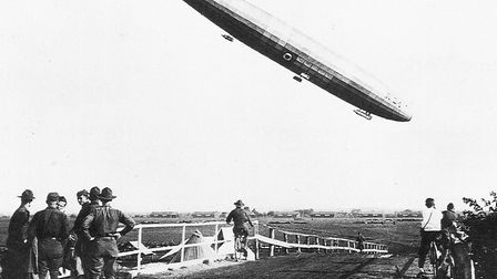 Historic landing: with American soldiers looking on, R34 makes a steep descent onto Long Island wher