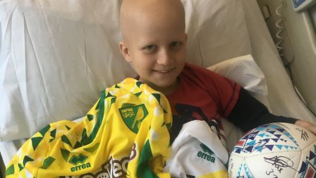 Ollie Elvin, nine, from Dussindale, organising the signe Norwich City Football Club shirt give away