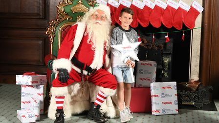 Nine-year-old Ollie Elvin, from Dussindale in Norwich, enjoying a belated Christmas celebration put
