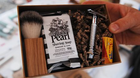 A plastic-free shaving kit including a stainless steel razor and solid shaving soap Picture: Chris