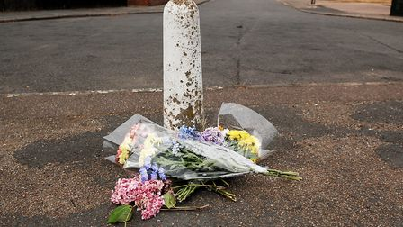 Flowers left near the spot where Reece Hornibrook was injured, at the junction of Saddlebow Road and
