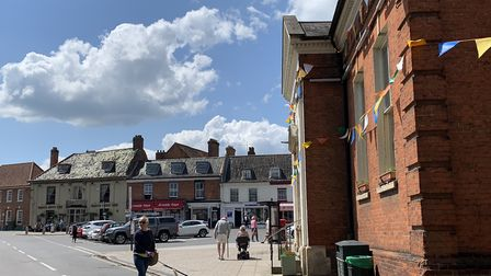 Aylsham's Heritage Trust owned Market Place, with the town hall to the right, and the Black Boys pub