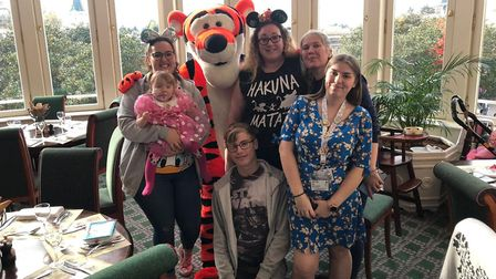 Emily Mullen and her family with Tiger at Disneyland Paris. PHOTO: Amie Mullen