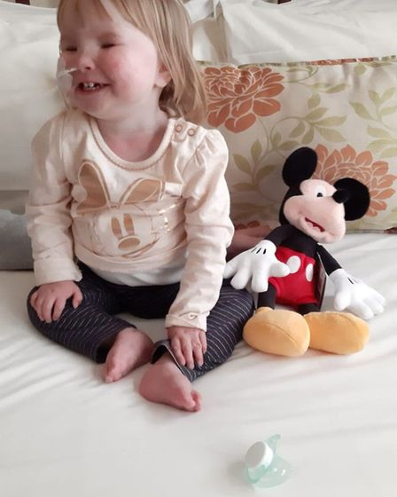 Emily Mullen with her Mickey Mouse toy. PHOTO: Amie Mullen