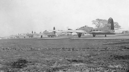 Bastion of the Mighty Eighth: a procession of B-17 Flying Fortresses of the 100th Bomb Group at Thor