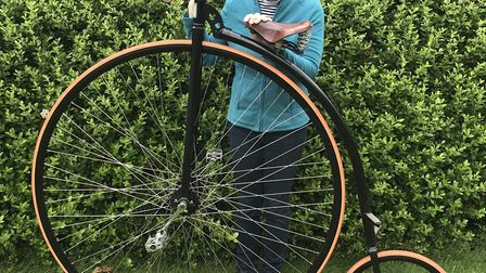 Beverley Wakefield with her penny farthing Picture: QEH